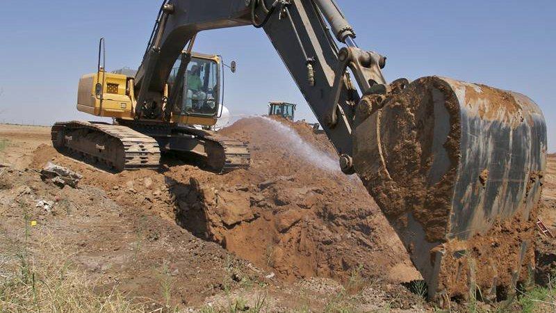 Kelly Burt Dozer Inc. excavating sand materials in Bryan, TX