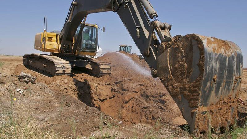 Kelly Burt Dozer Inc. excavating sand materials in Bryan, TX