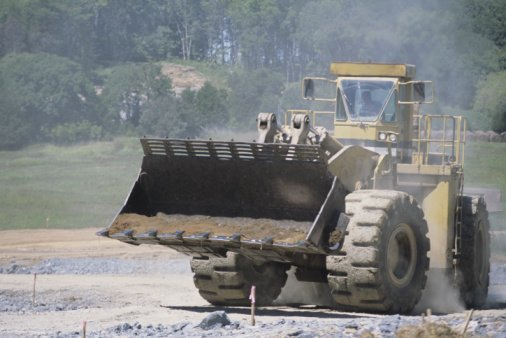 Excavation contractor hauling gravel material