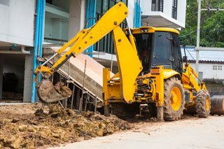Kelly Burt Dozer Inc. hauling sand materials