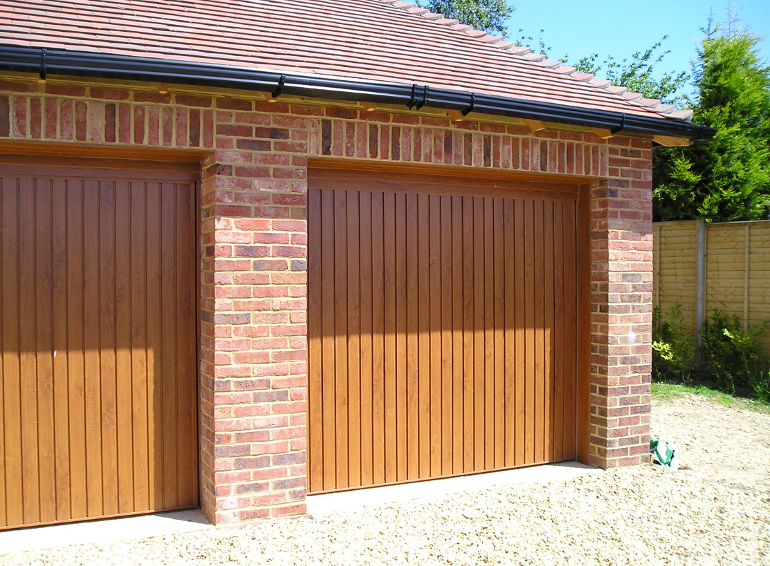 View of wooden garage door installed in Sussex