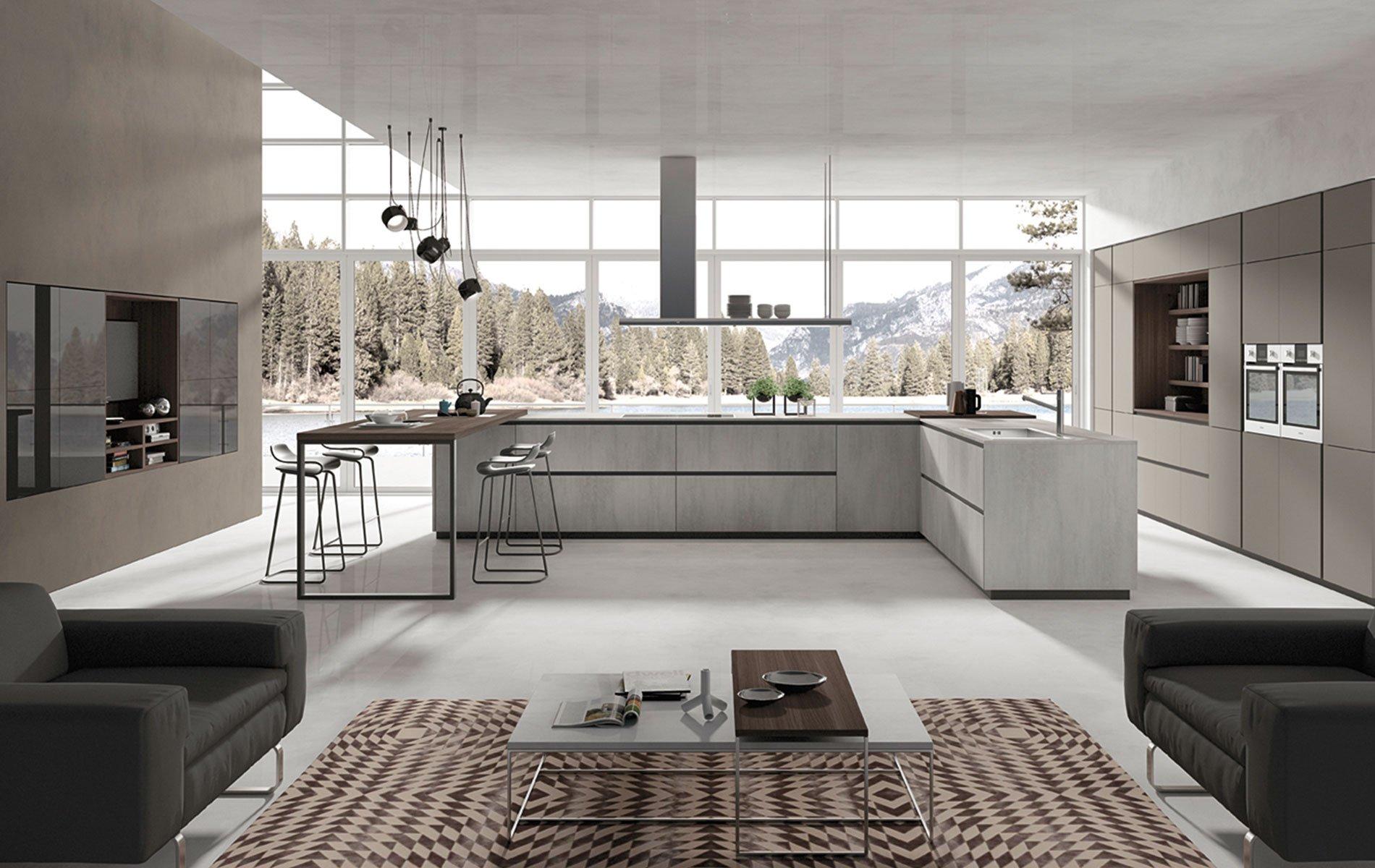 una cucina open space con mobili angolari