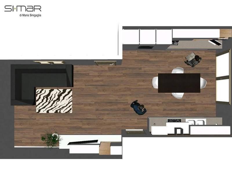 vista dall'alto di un'immagine in Cad di un salotto, una cucina open space e una coppia