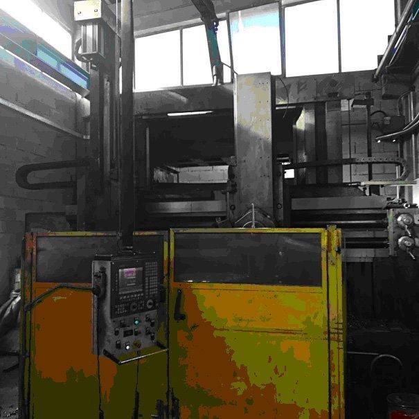 macchinario per la lavorazione di componenti metallici