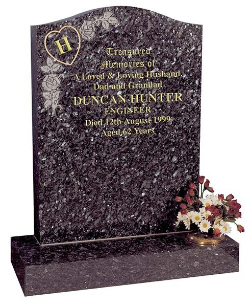 coarse grained granite headstone with coloured infill