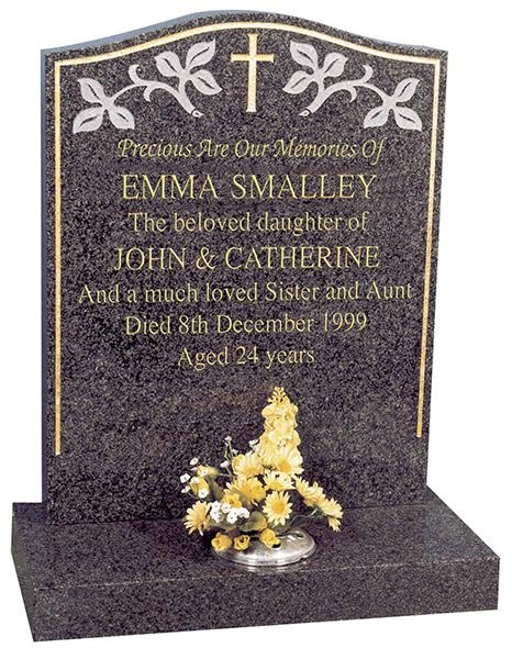 headstone with white infilled decoration and lettering