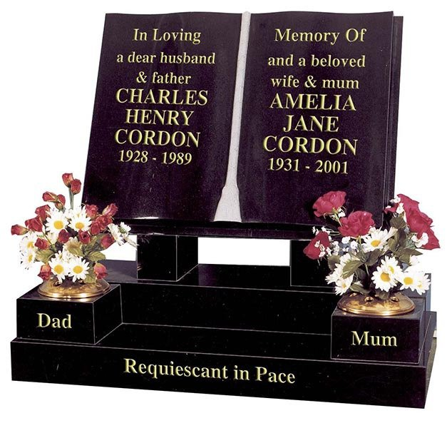 two book pages headstone