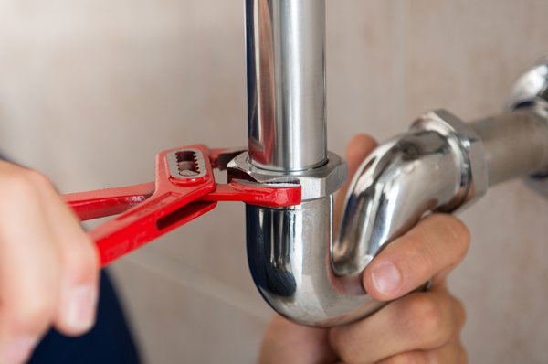 man using wrench