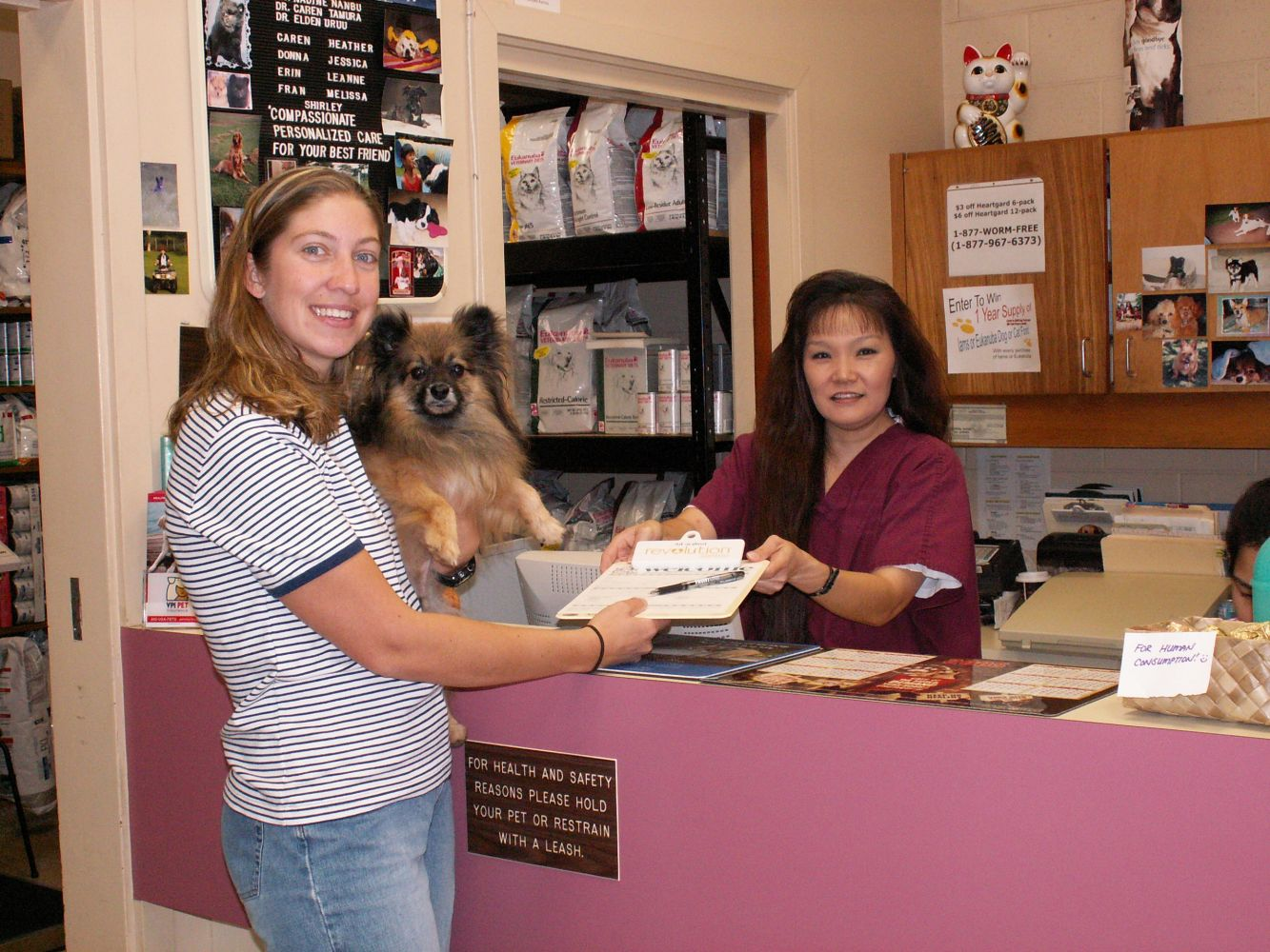 A dog and its owner at the front desk of our clinic