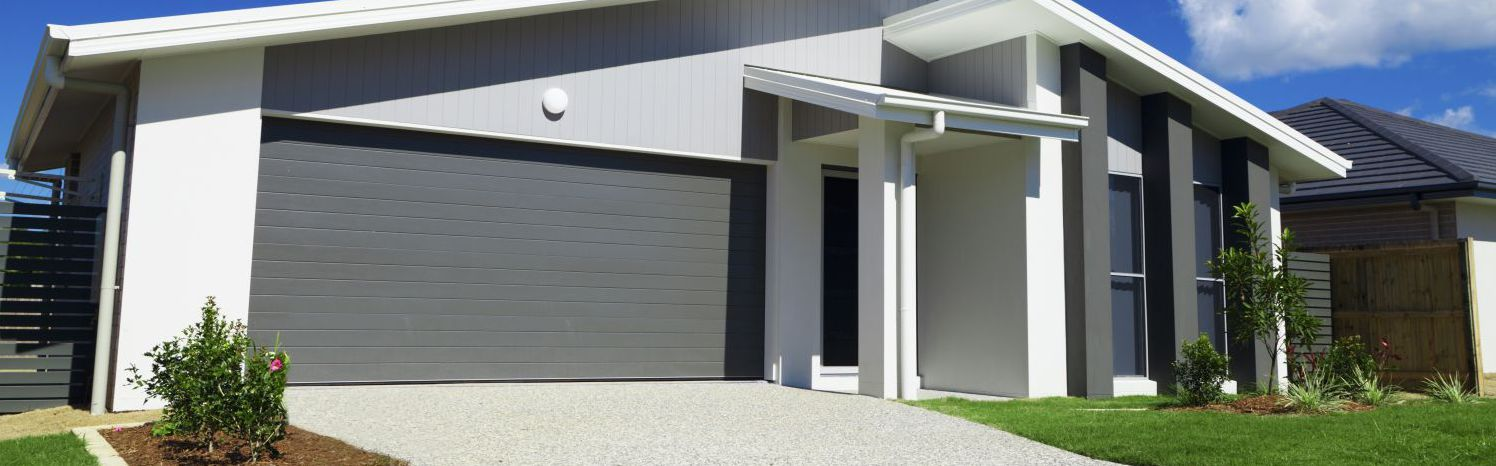 Roller garage door servicing in Auckland