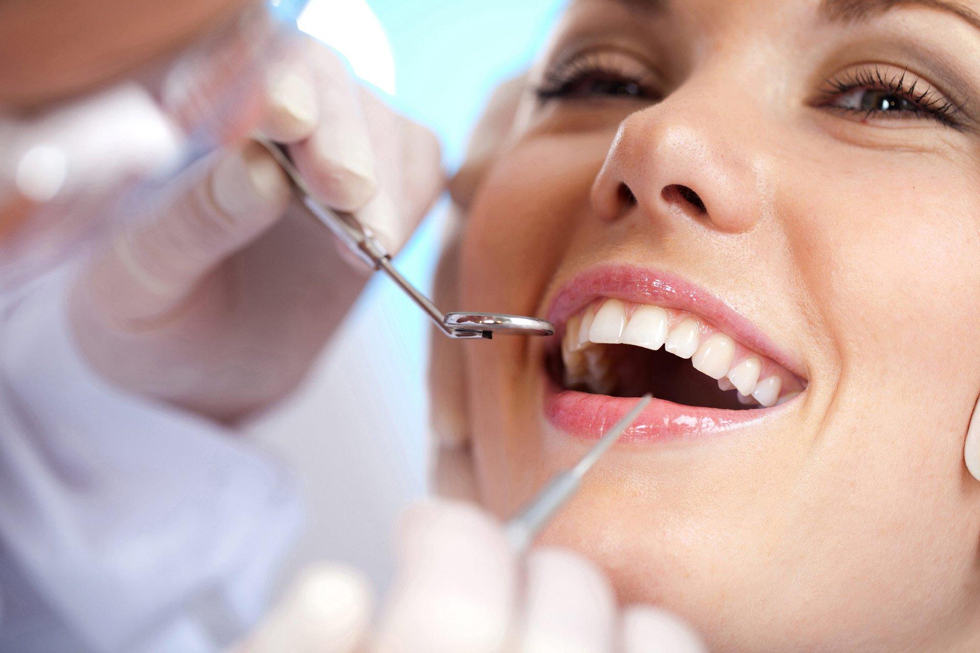 women getting teeth fixed