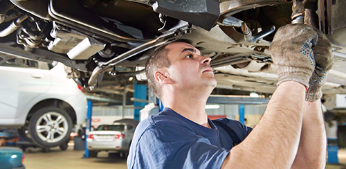 Quality automobile servicing being done by professionals