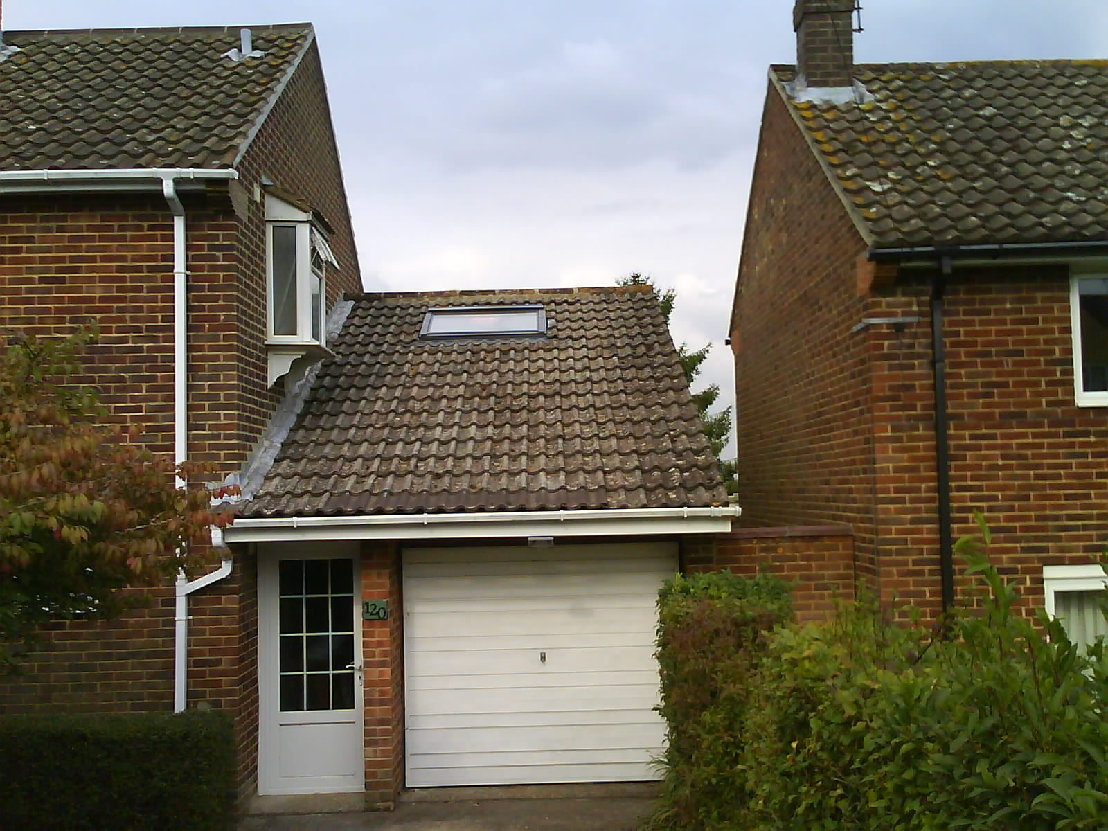 tiled roof above garage
