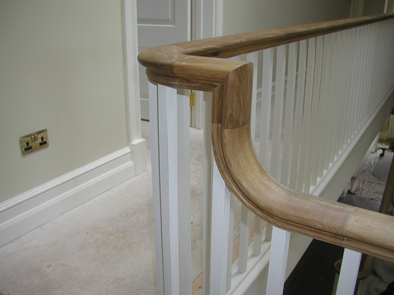 Wooden banister at the top of staircase