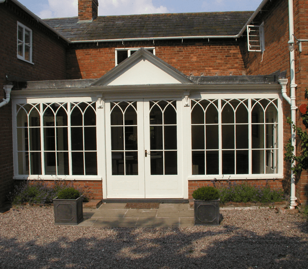 Large white wooden windows and double doors