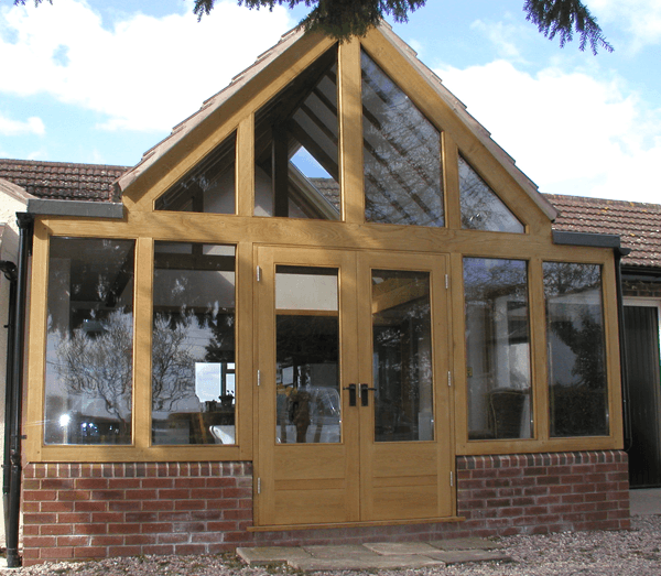 Wooden conservatory with wooden doors