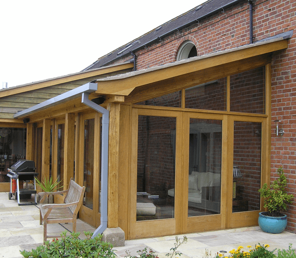 Large wooden conservatory by AR Manley