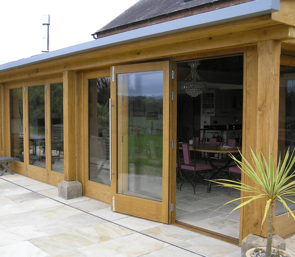 Wooden conservatory with sliding doors