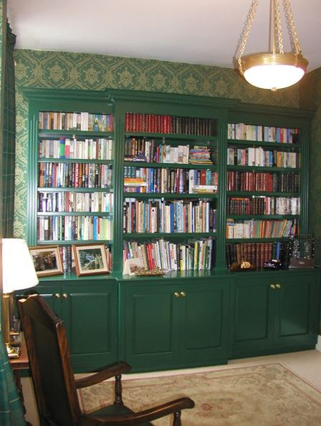 Green bookcase with cupboards
