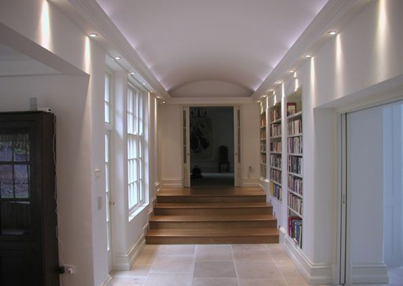 Hallway with fitted bookcases