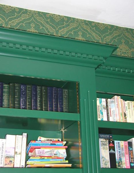 Details at the top of green bookcase