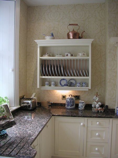 Kitchen shelving fitted on a wall