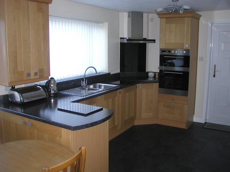 Large kitchen with fitted wooden cabinets