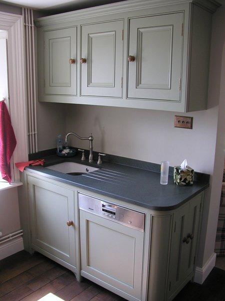 Cream kitchen with grey worktops