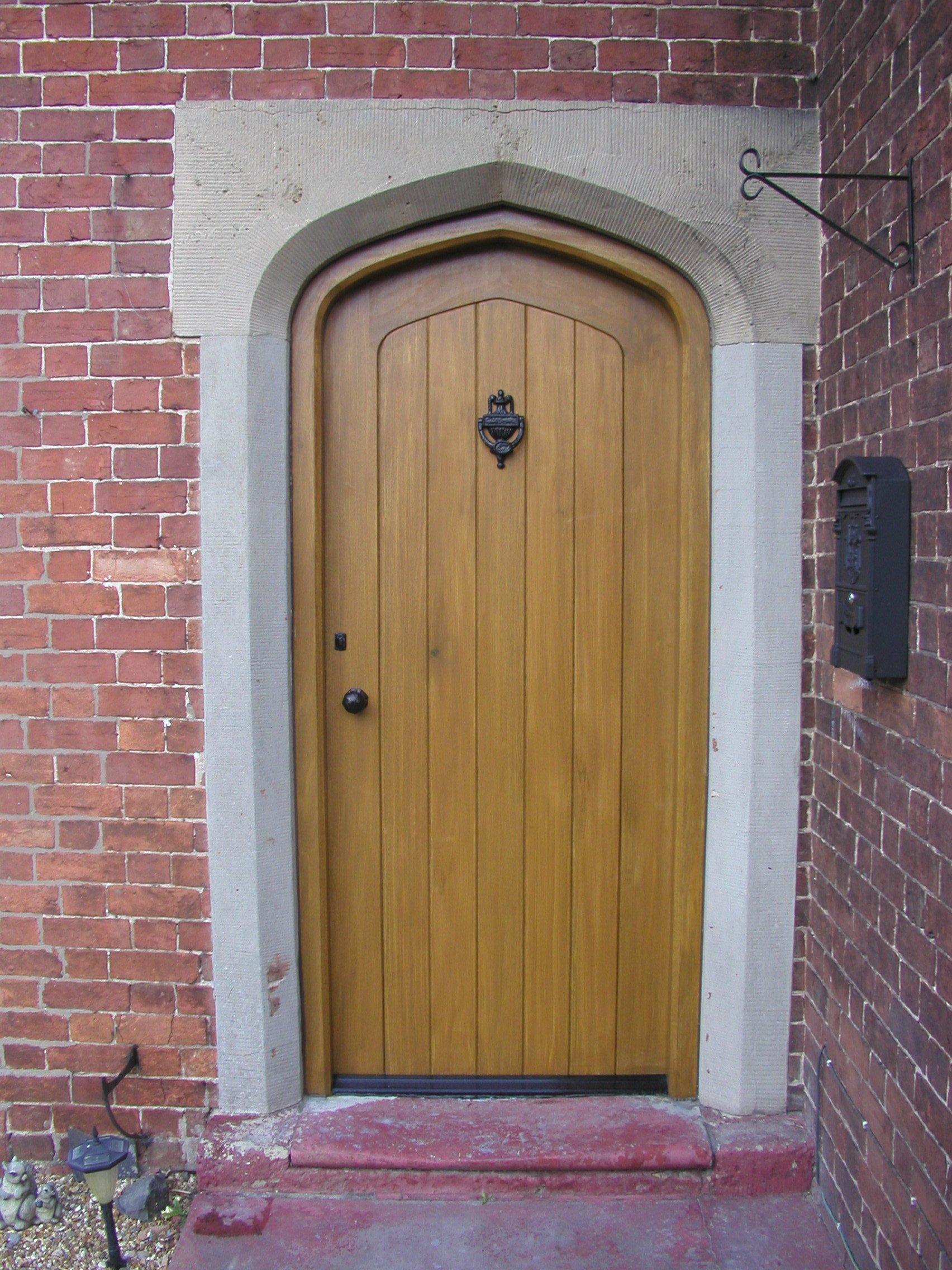 Large wooden door with metal features