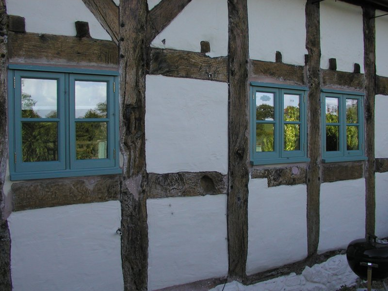 Small blue wooden windows