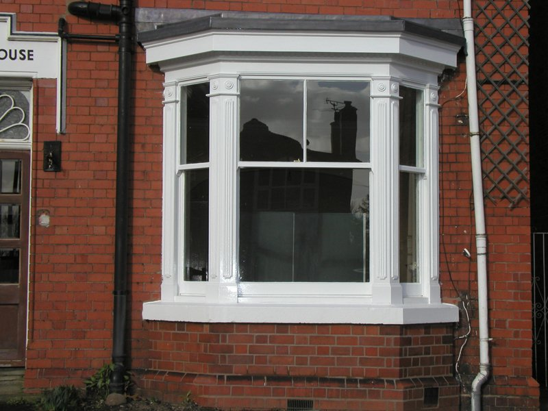 Large white window made and installed by AR Manley