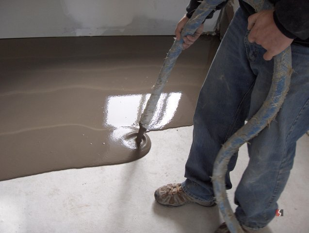 Liquid concrete being poured on the floor in Lincoln, NE