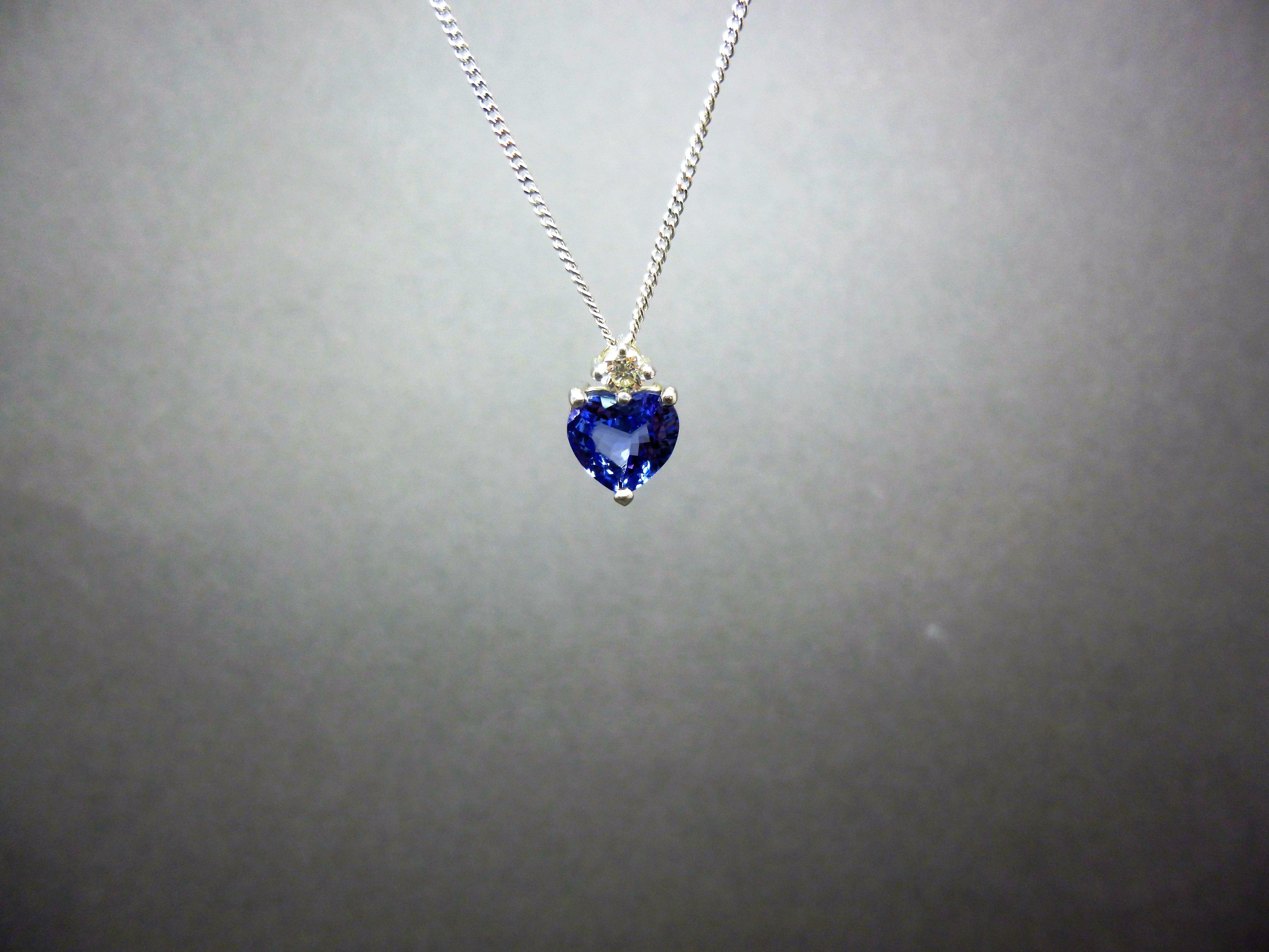 The blue tanzanite of a tanzanite and diamond pendant