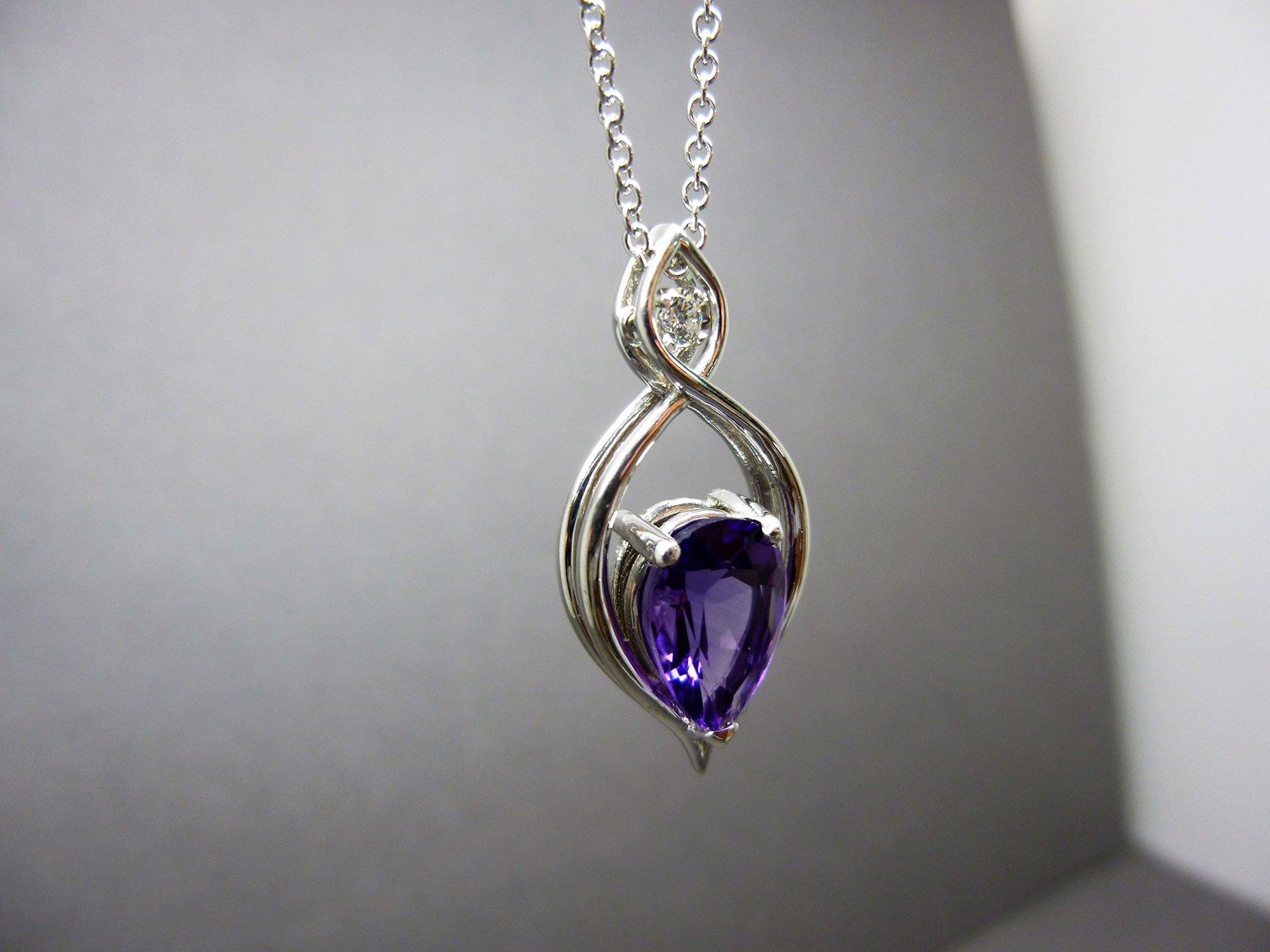 An amethyst and diamond pendant close up