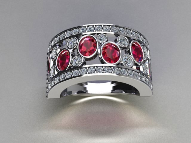 Close up of a ruby and diamond ring laid down