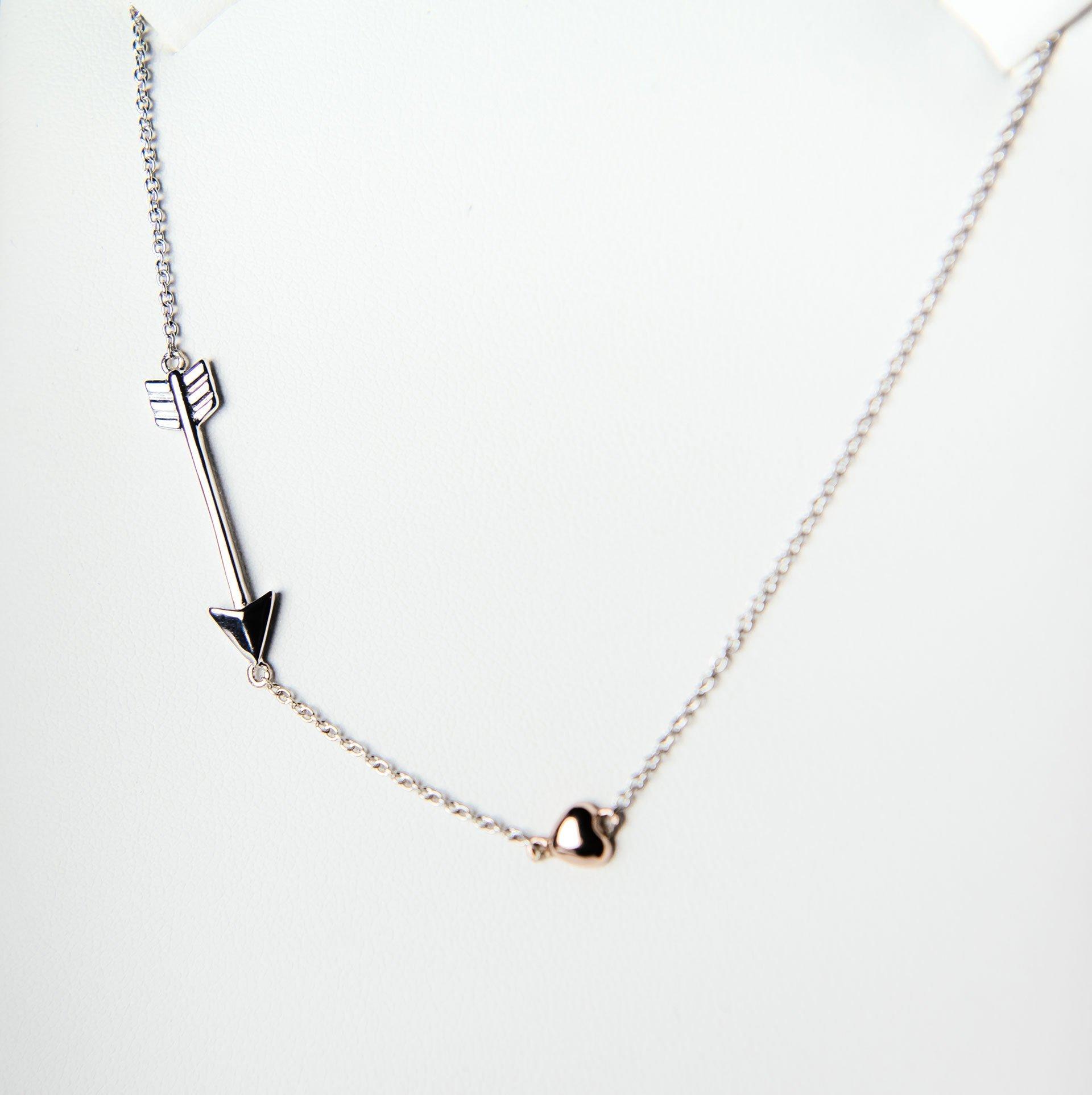 An arrow and heart on a chain