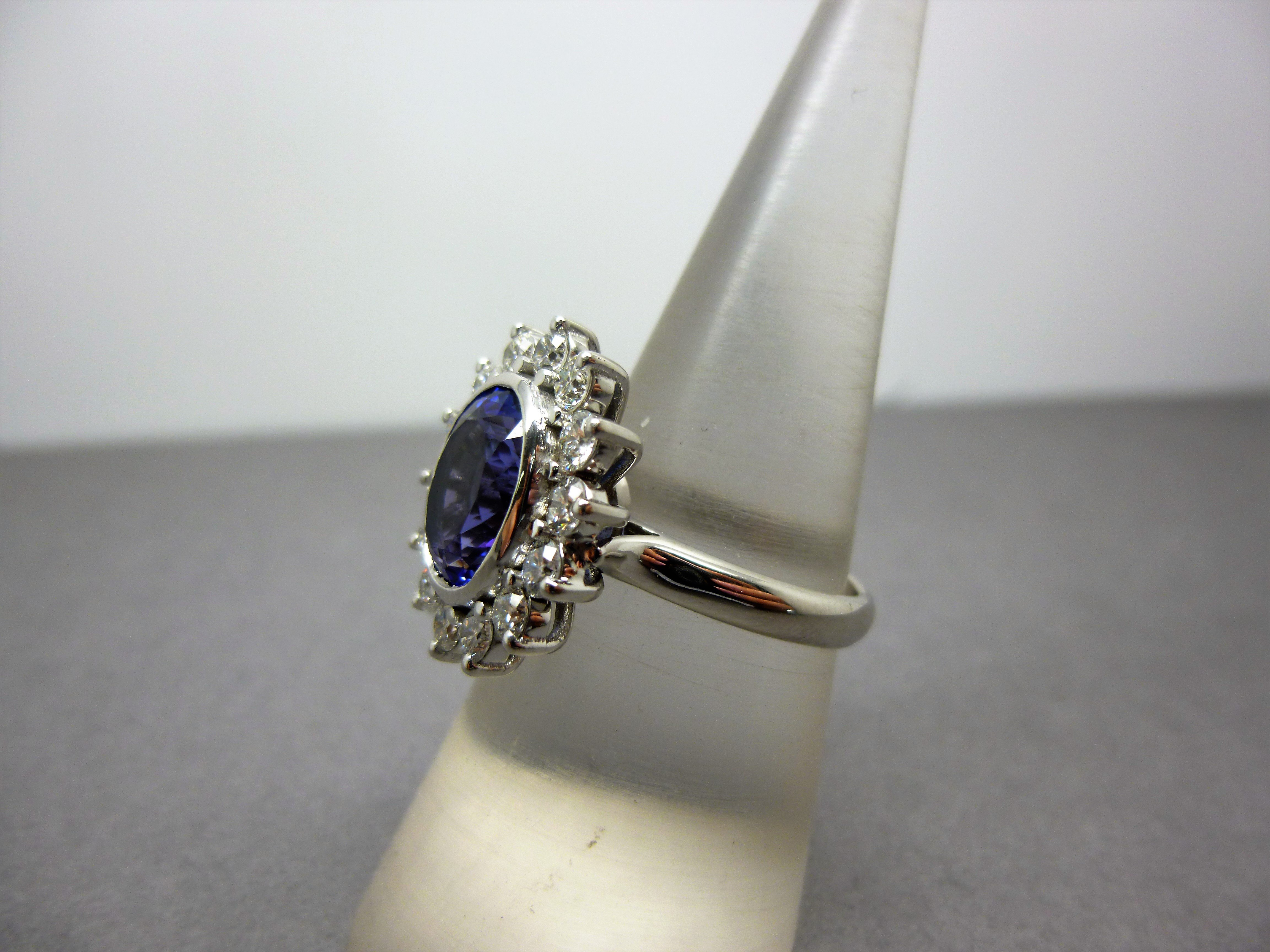 A finished tanzanite and diamond cluster ring