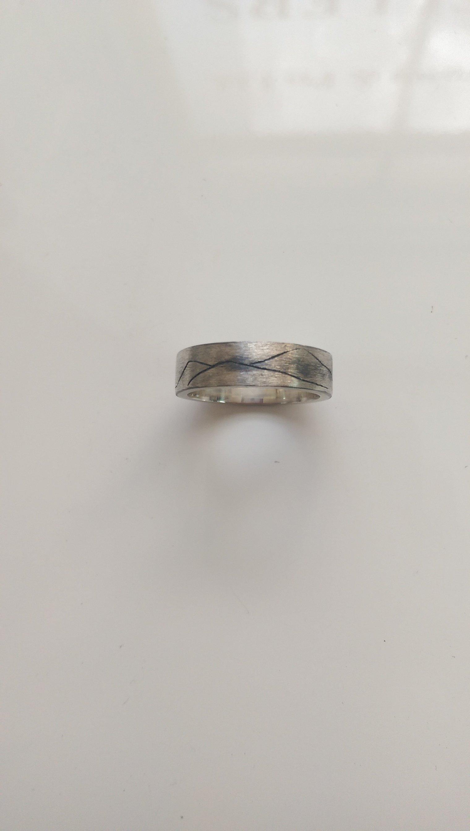 An engraved wedding ring