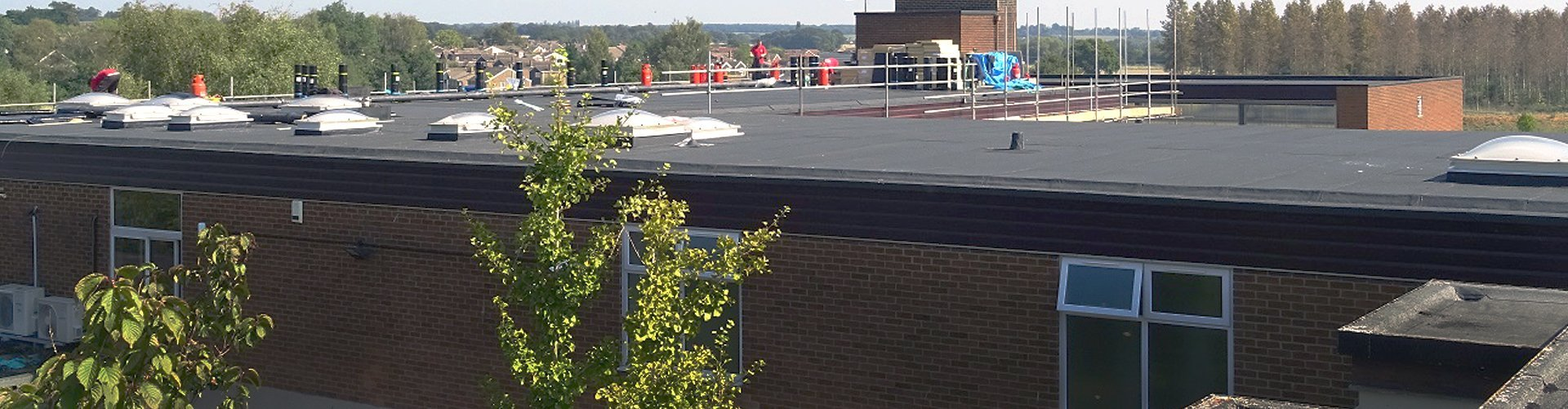 A fascia board around a school building that has been worked on by Accurate Flat Roofing