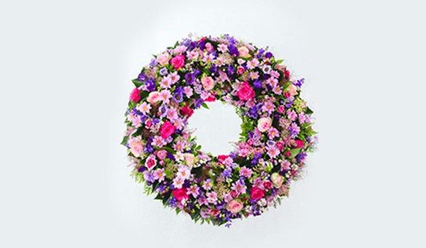 corona di fiori rosa,viola e fucsia