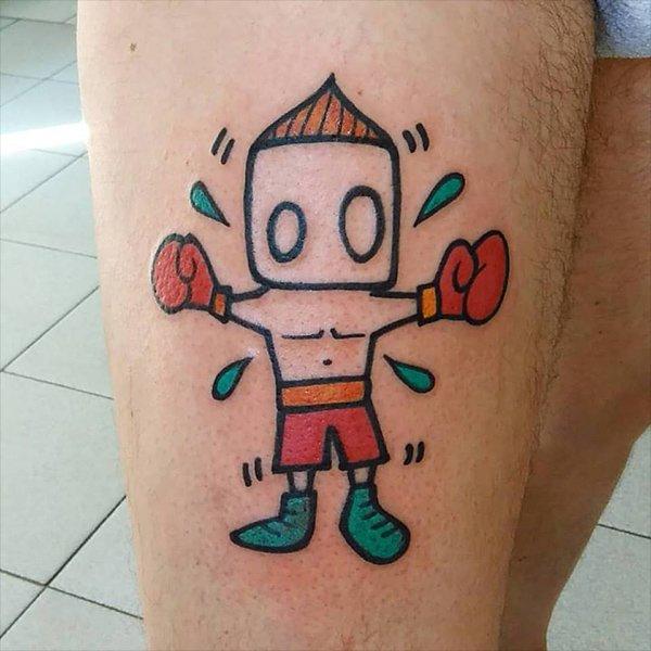 tatuaggio di un pugile sul polpaccio