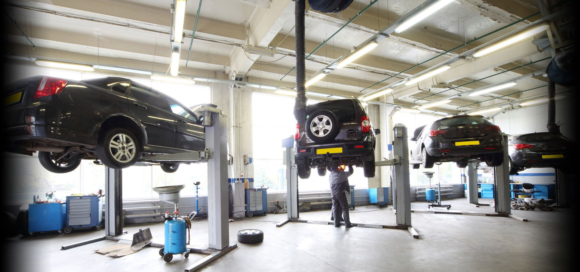 Cars on ramps in the workshop