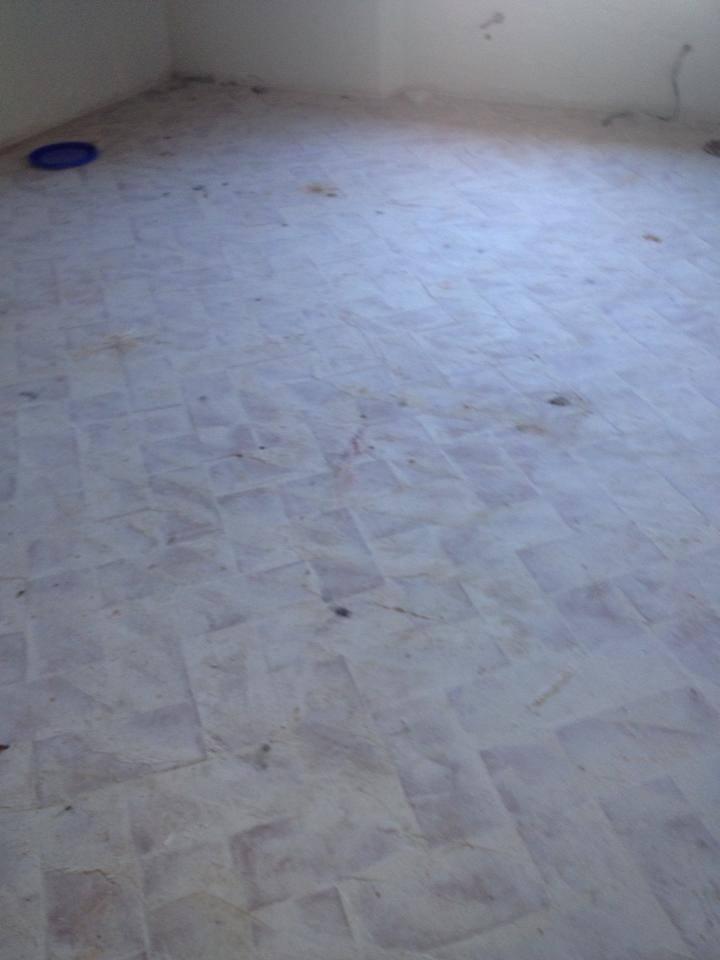 pavimento in cotto fugato bianco prima della levigatura e trattamento