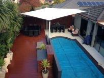 shades of blue shade sails swimming pool with shade
