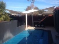 shades of blue shade sails swimming pool in house