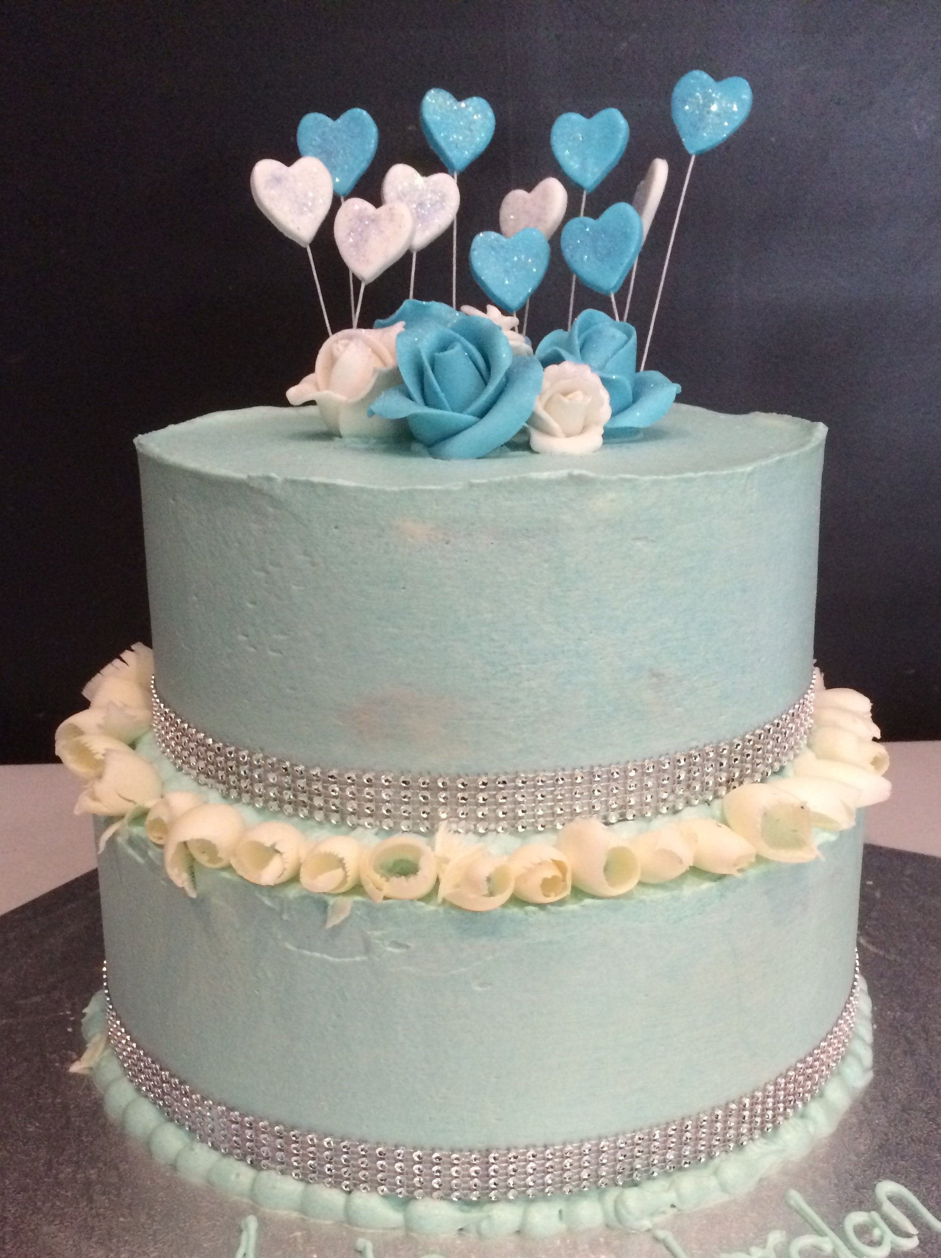 double stack blue cake with hearts