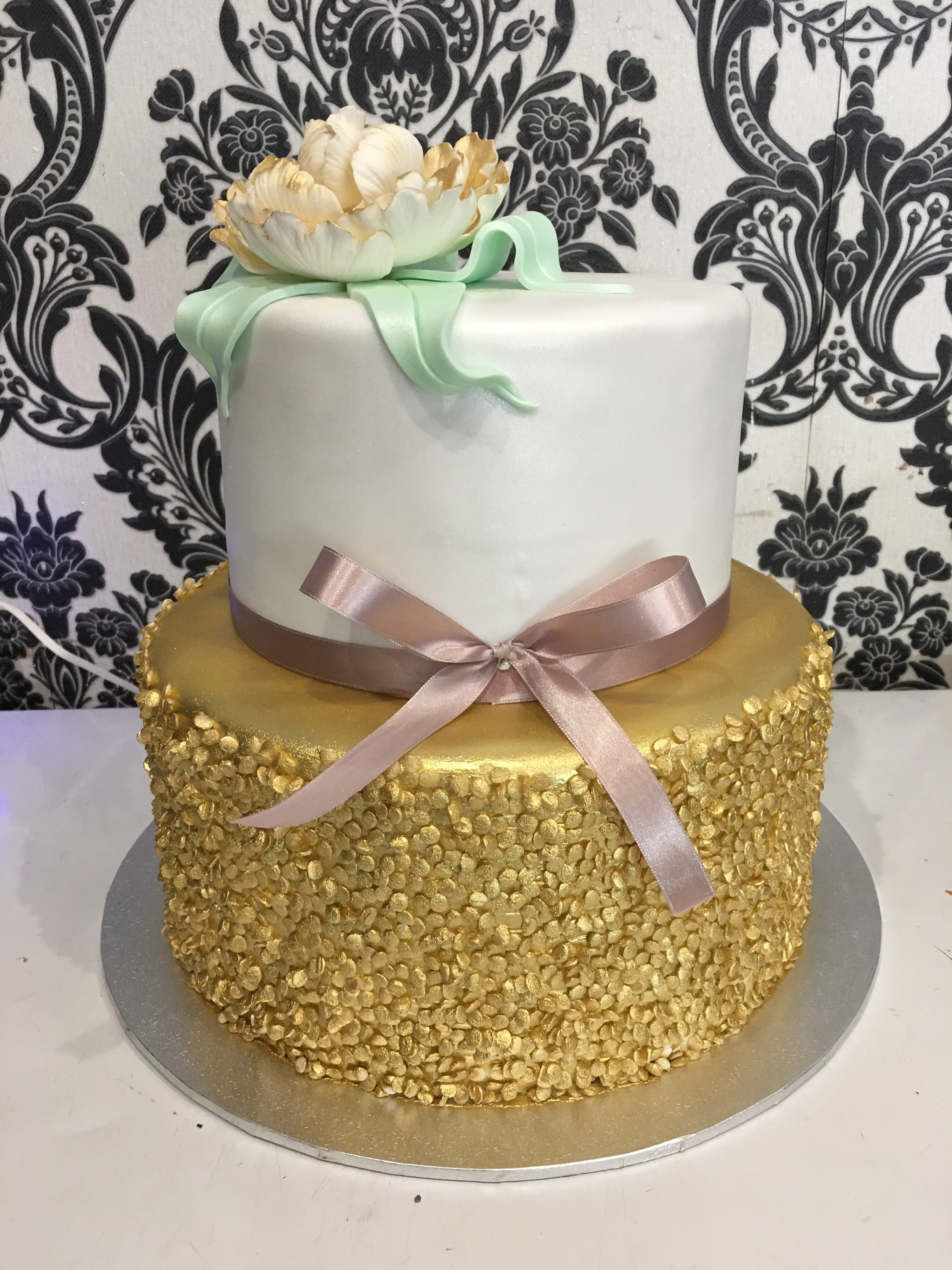 double tier christening cake with gold bottom