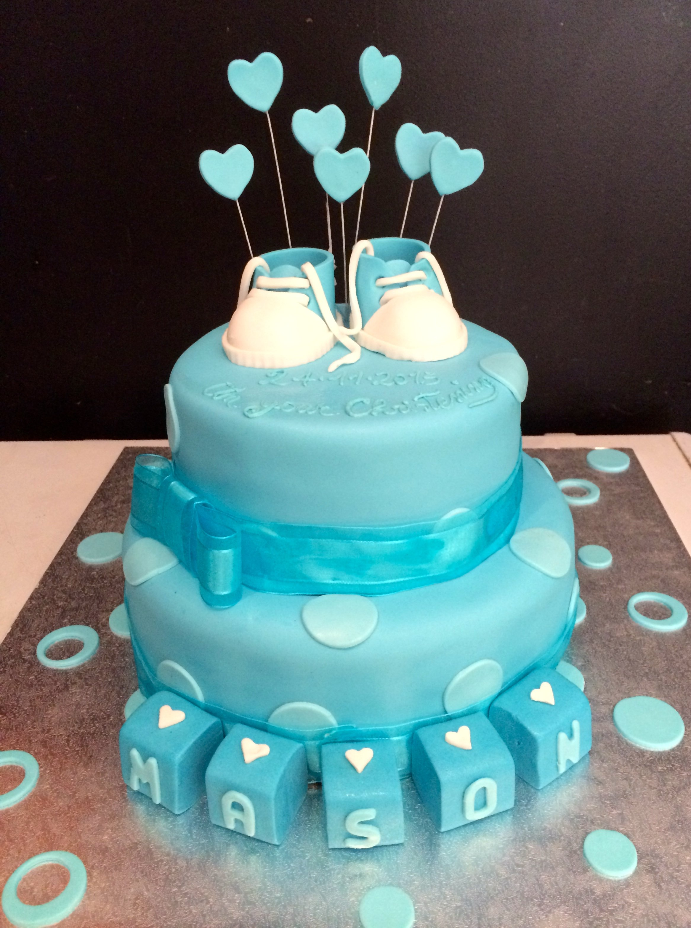 blue double layer christening cake with letter blocks shoes and hearts