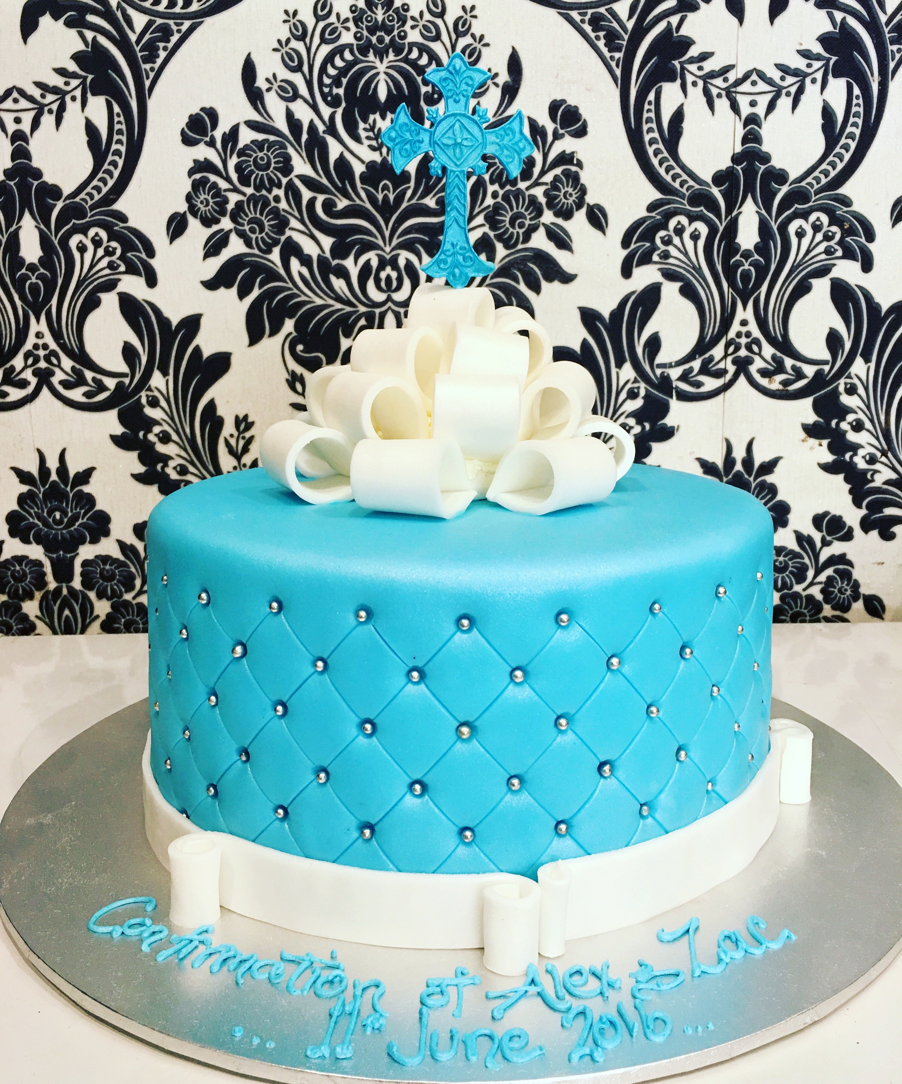 blue pillow effect confirmation cake with blue cross