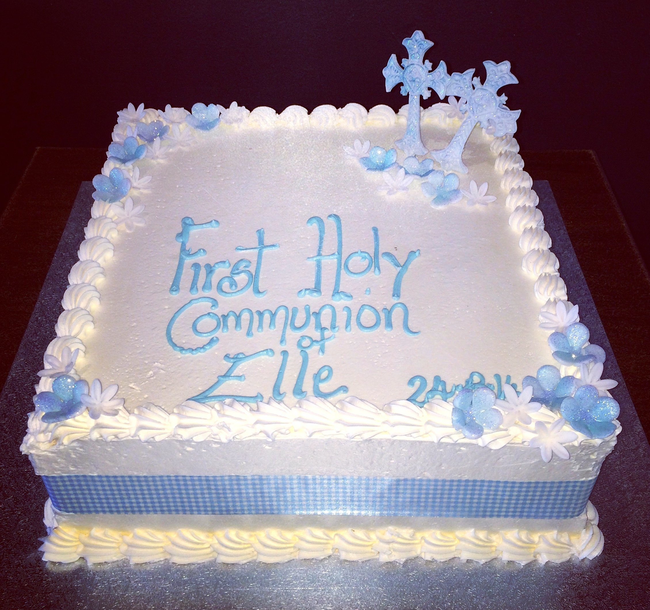 white holy communion cake with silver cross and stars